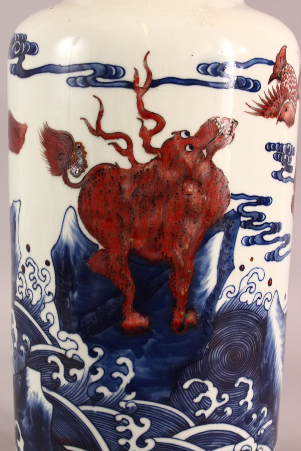 A CHINESE IRON RED, BLUE AND WHITE VASE, the body painted with mythical creatures amongst stylised - Image 2 of 7