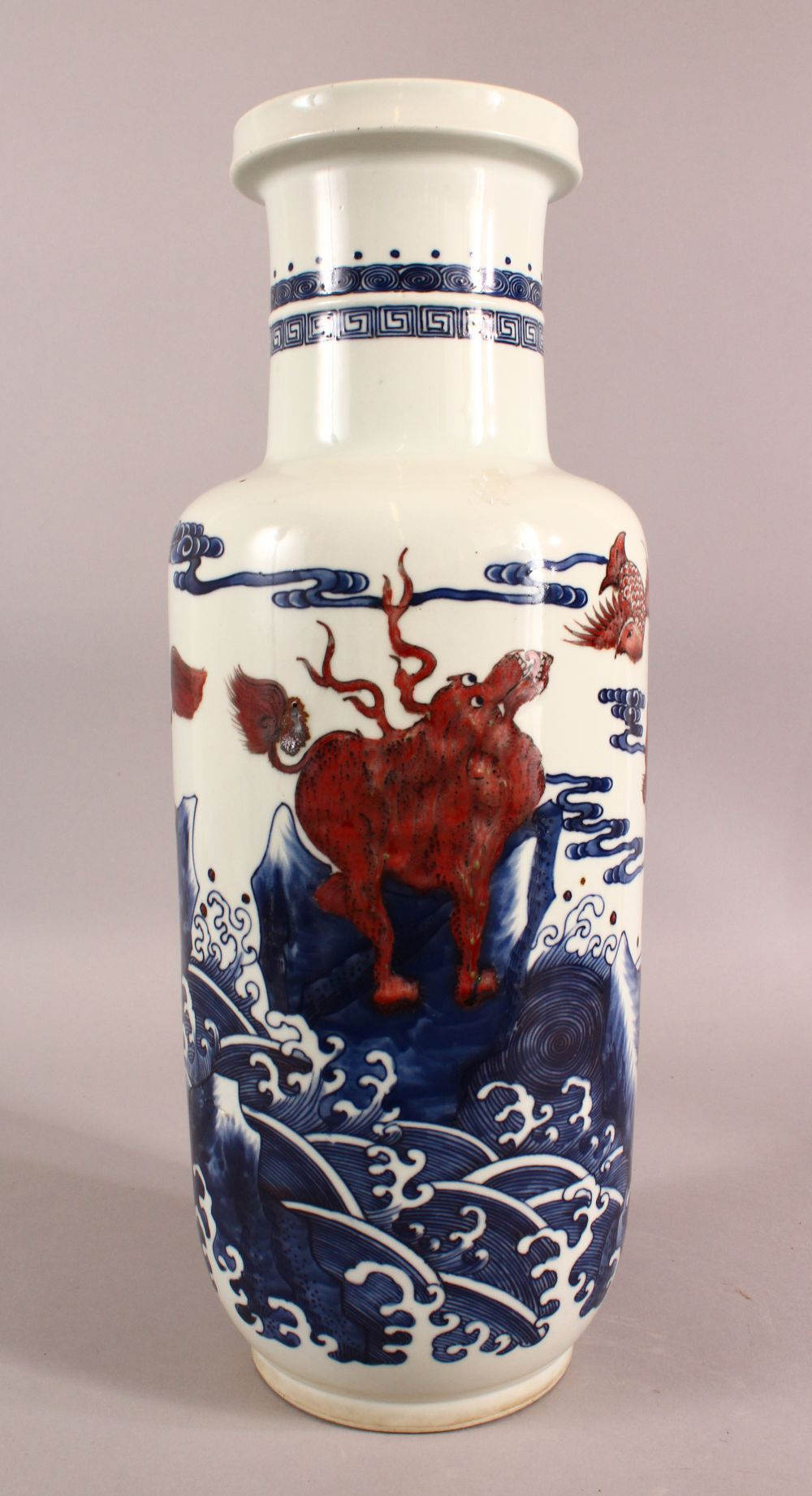 A CHINESE IRON RED, BLUE AND WHITE VASE, the body painted with mythical creatures amongst stylised