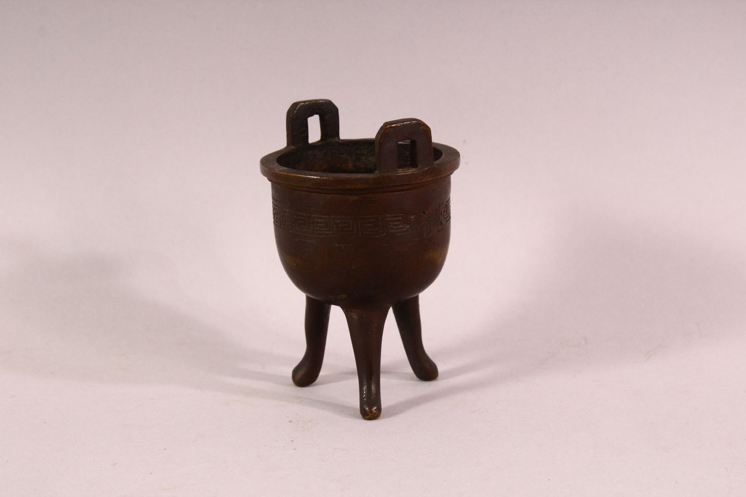A SMALL 19TH CENTURY CHINESE TWIN HANDLE TRIPOD CENSER, the body with greek key decoration, 9.5cm - Image 3 of 5