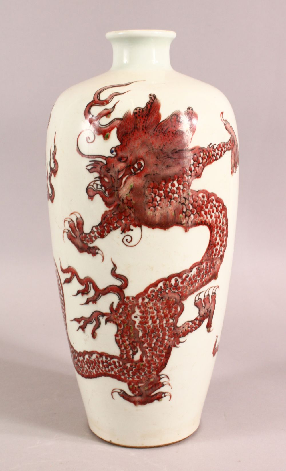 A CHINESE IRON RED DRAGON VASE, the body painted with two dragons and the pearl of wisdom, 33cm