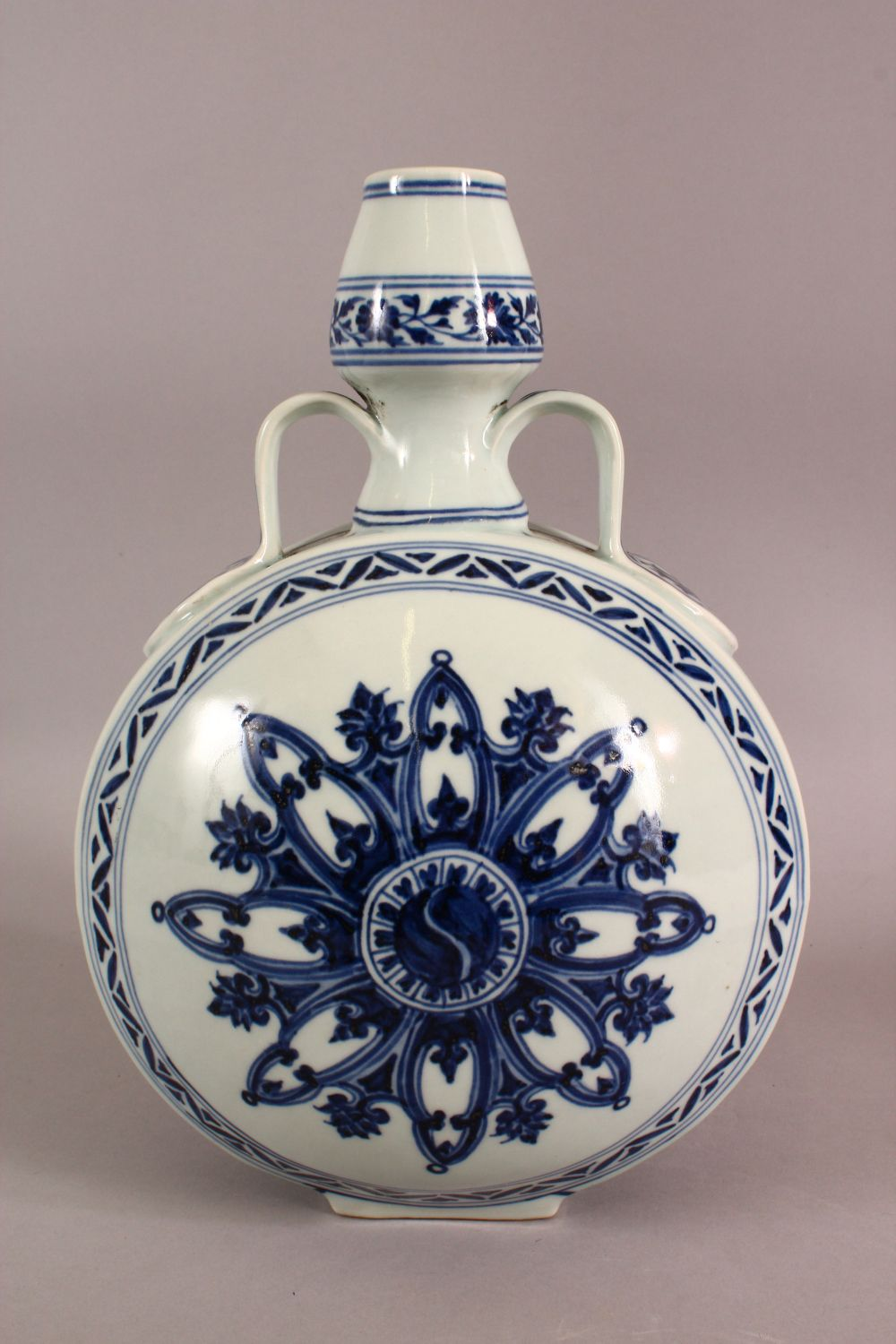 A CHINESE BLUE AND WHITE TWIN HANDLED PORCELAIN MOON FLASK, painted with stylised motifs, six - Image 4 of 6
