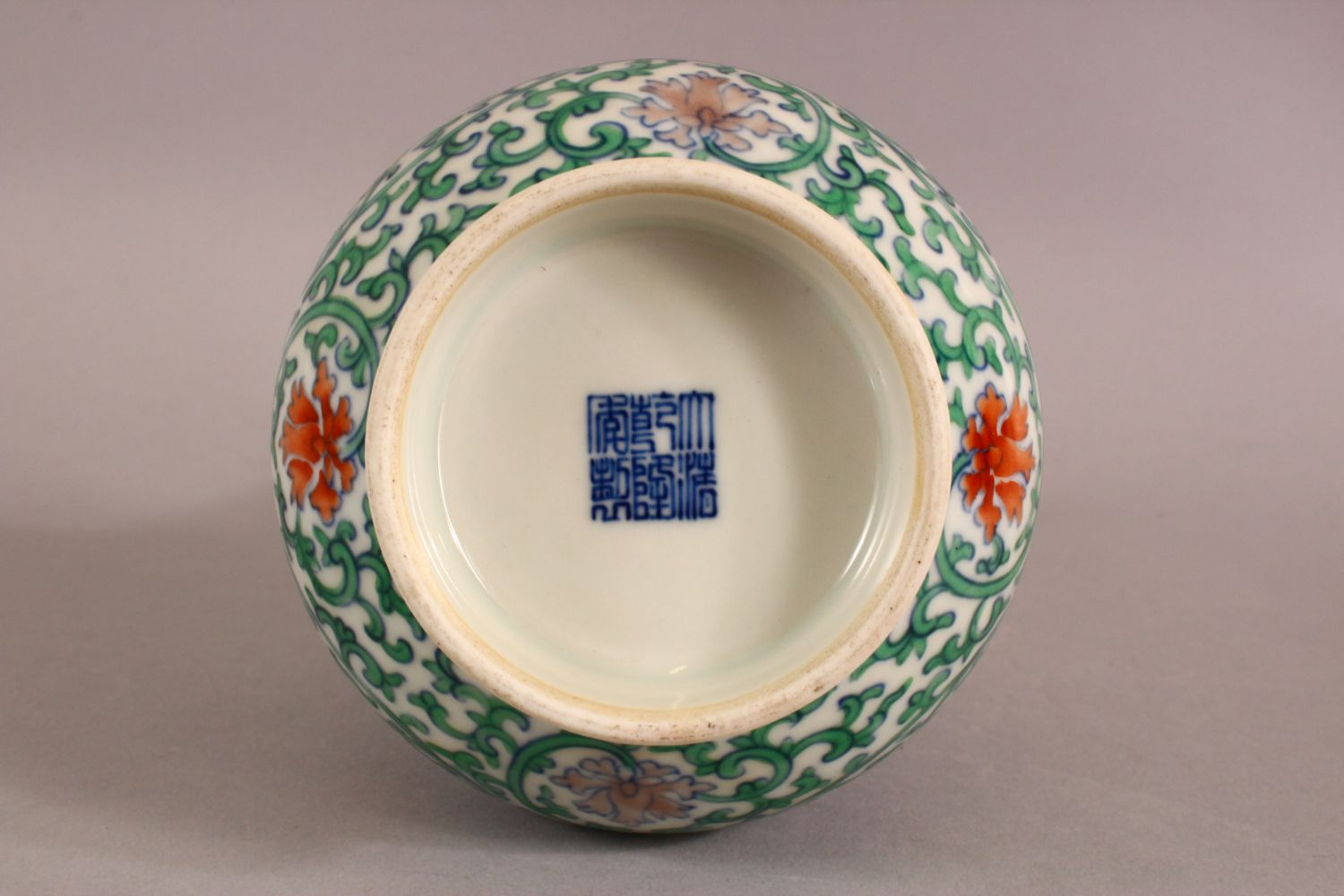 A SMALL CHINESE FAMILLE VERTE PORCELAIN VASE, profusely painted with flowers and vines, six - Image 5 of 6