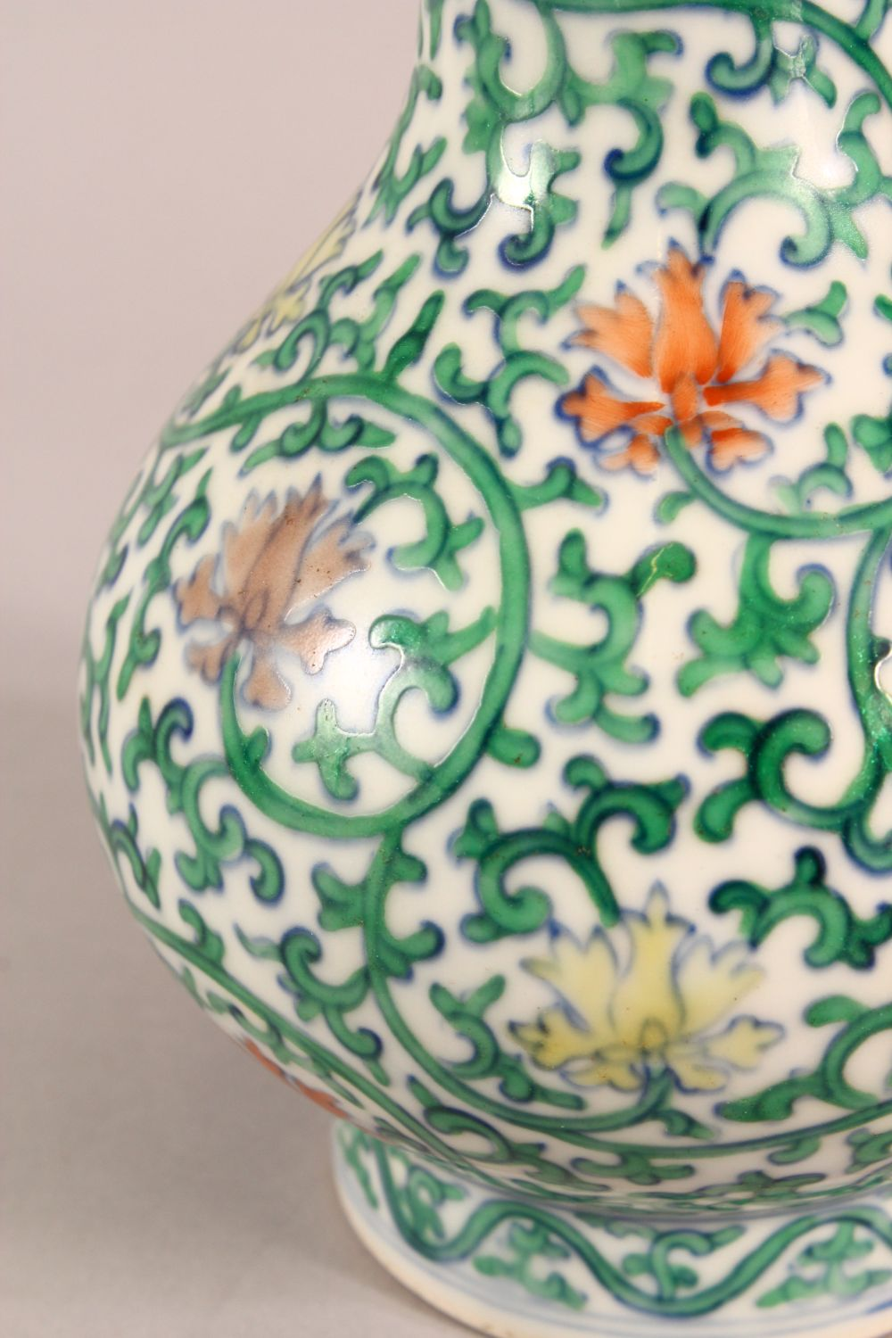 A SMALL CHINESE FAMILLE VERTE PORCELAIN VASE, profusely painted with flowers and vines, six - Image 4 of 6