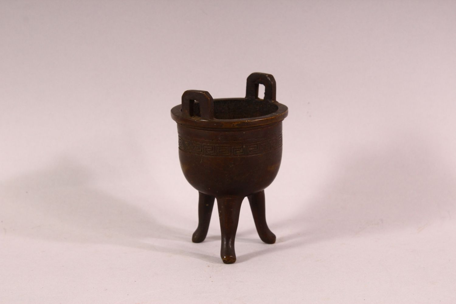 A SMALL 19TH CENTURY CHINESE TWIN HANDLE TRIPOD CENSER, the body with greek key decoration, 9.5cm - Image 2 of 5
