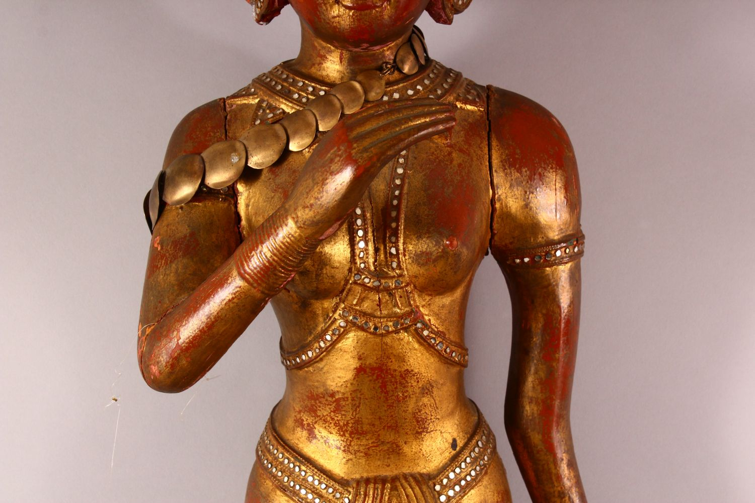 A LARGE THAI GILT AND RED LACQUER CARVED WOOD FIGURE, standing on a lotus base, 104cm high. - Image 3 of 8