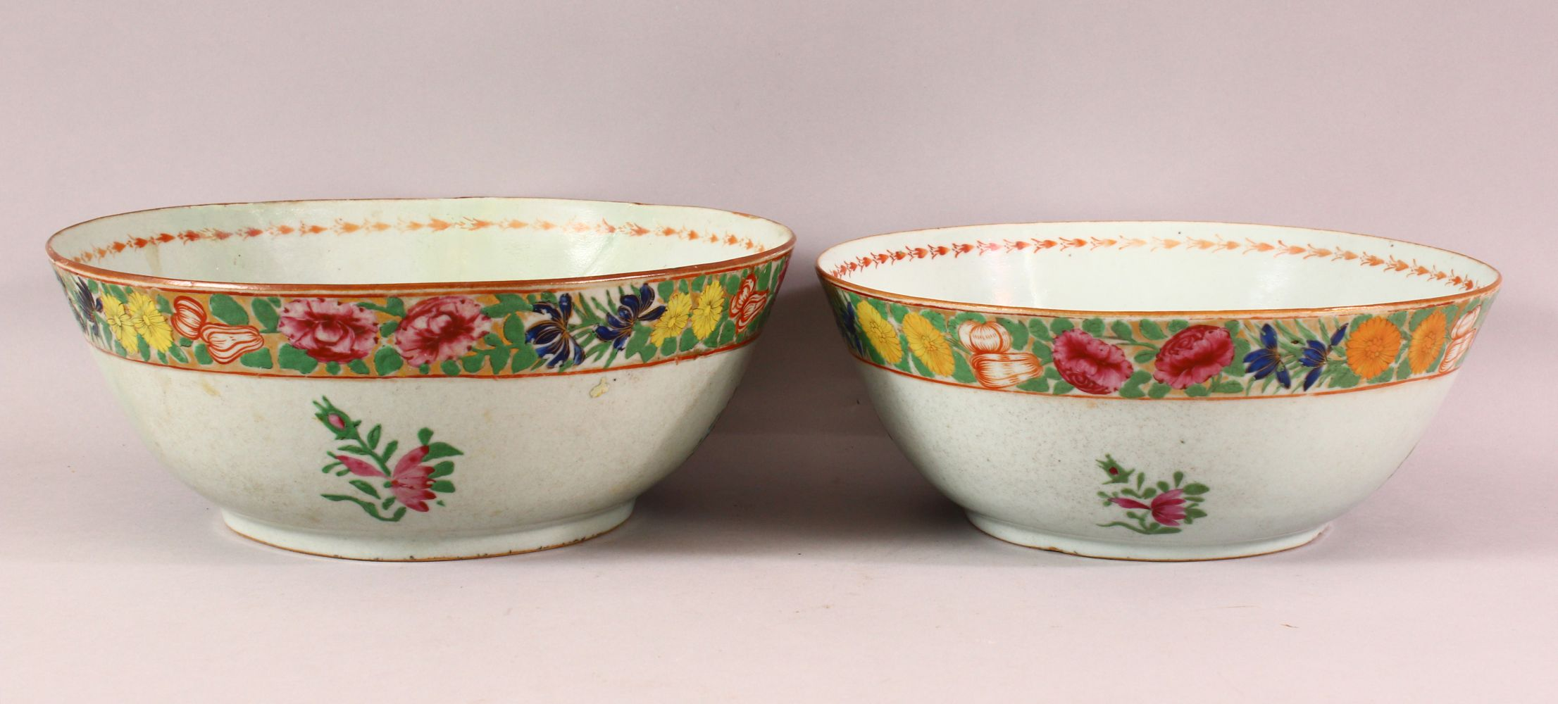 TWO 18TH / 19TH CENTURY CHINESE FAMILLE ROSE PORCELAIN BOWLS, each decorated with bands of flora, (