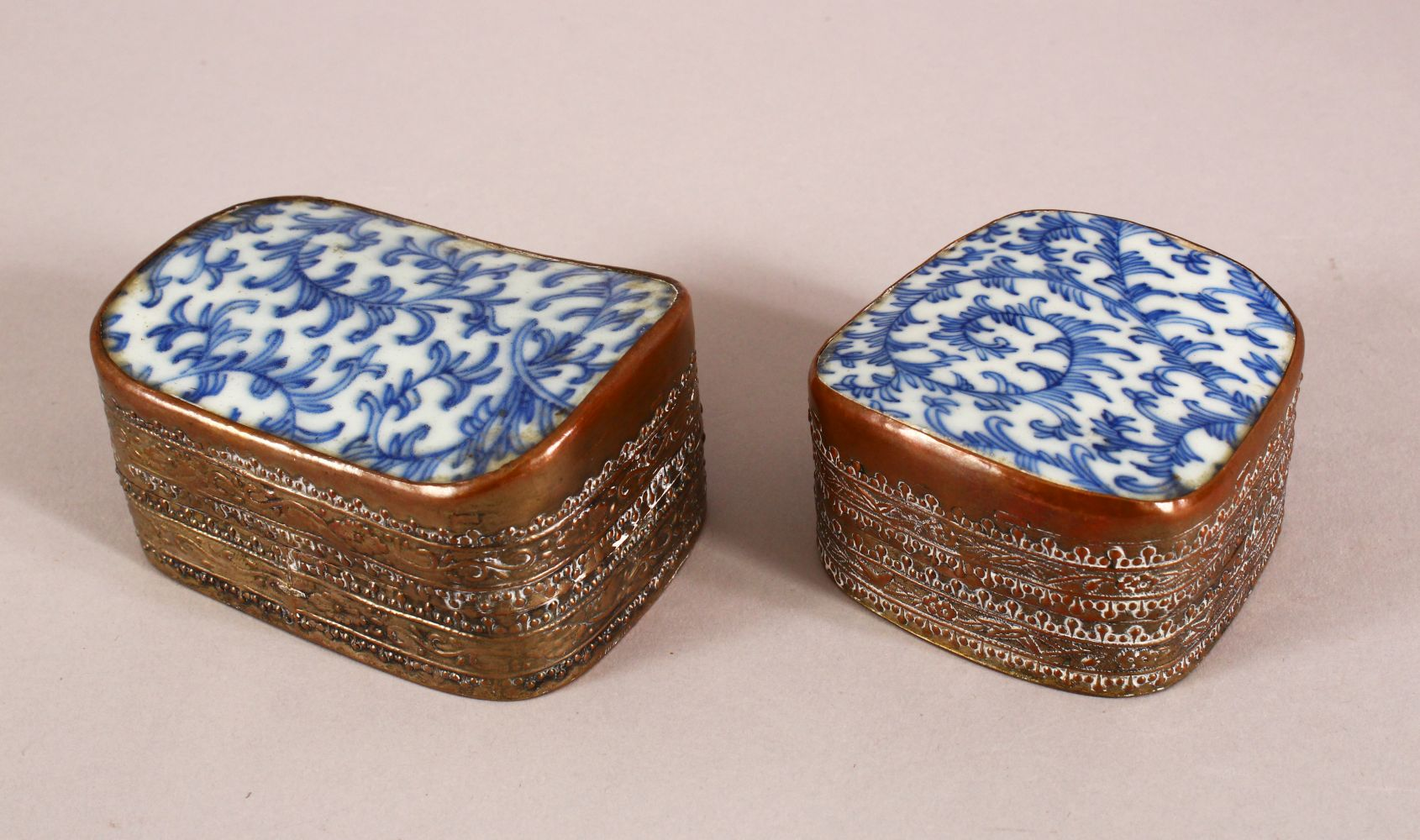 TWO 19TH CENTURY CHINESE BLUE AND WHITE PORCELAIN AND METAL POWDER BOXES, the metal mounts