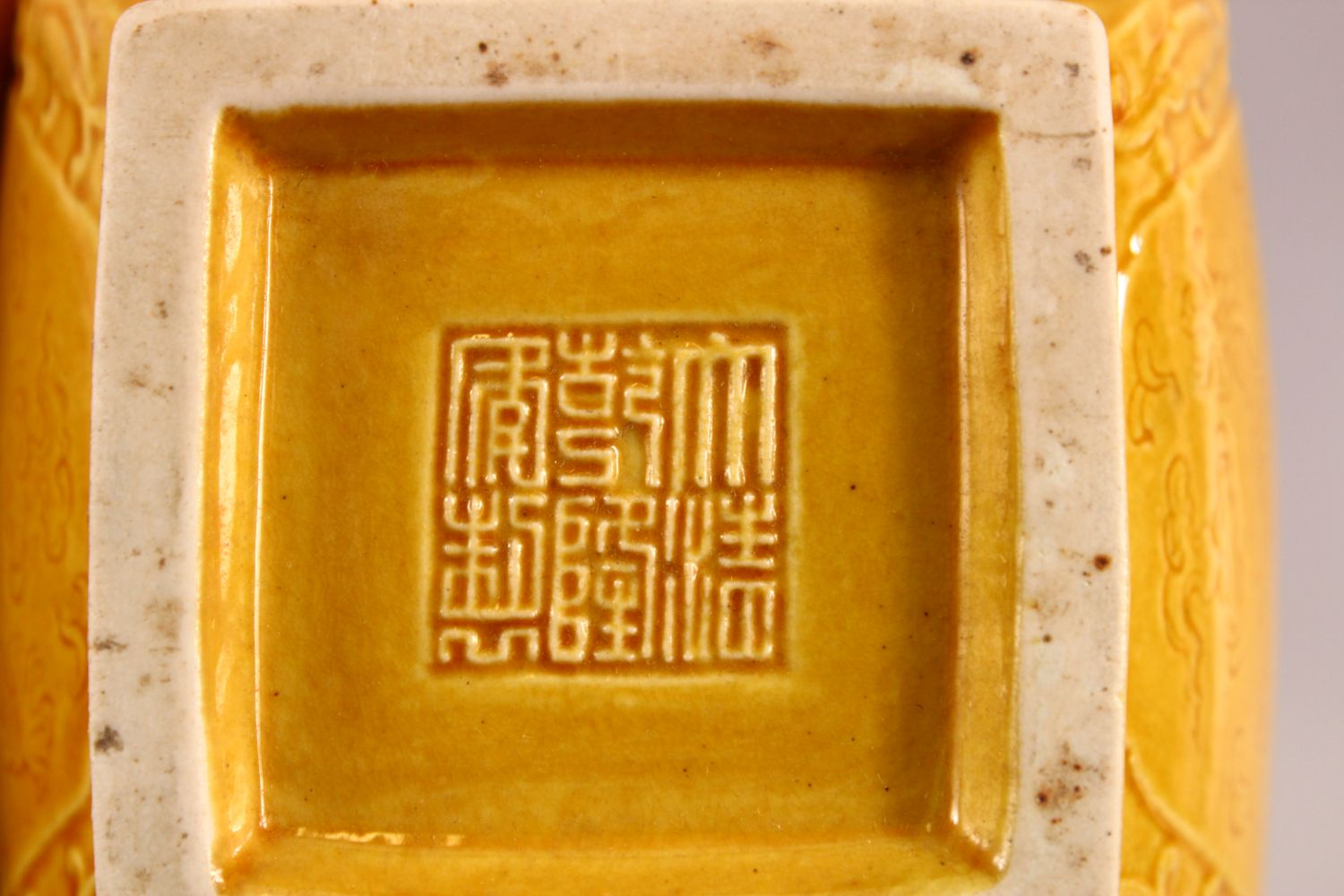 A SMALL CHINESE YELLOW GROUND SQUARE FORM VASE, with relief decoration of bats and stylised flora, - Image 6 of 6