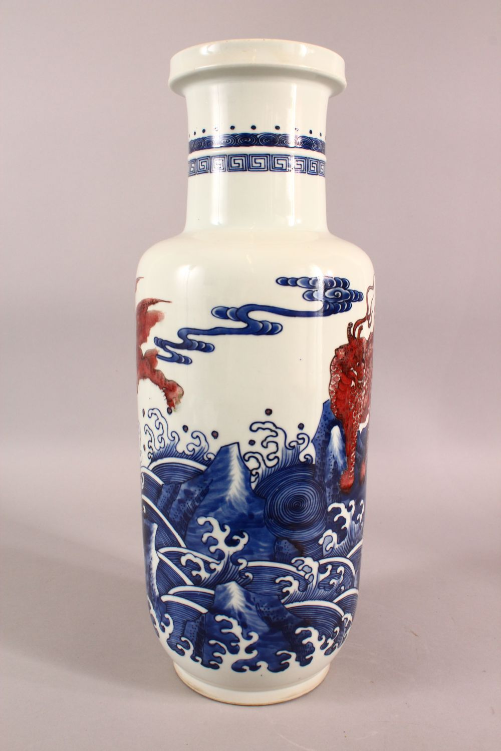 A CHINESE IRON RED, BLUE AND WHITE VASE, the body painted with mythical creatures amongst stylised - Image 4 of 7