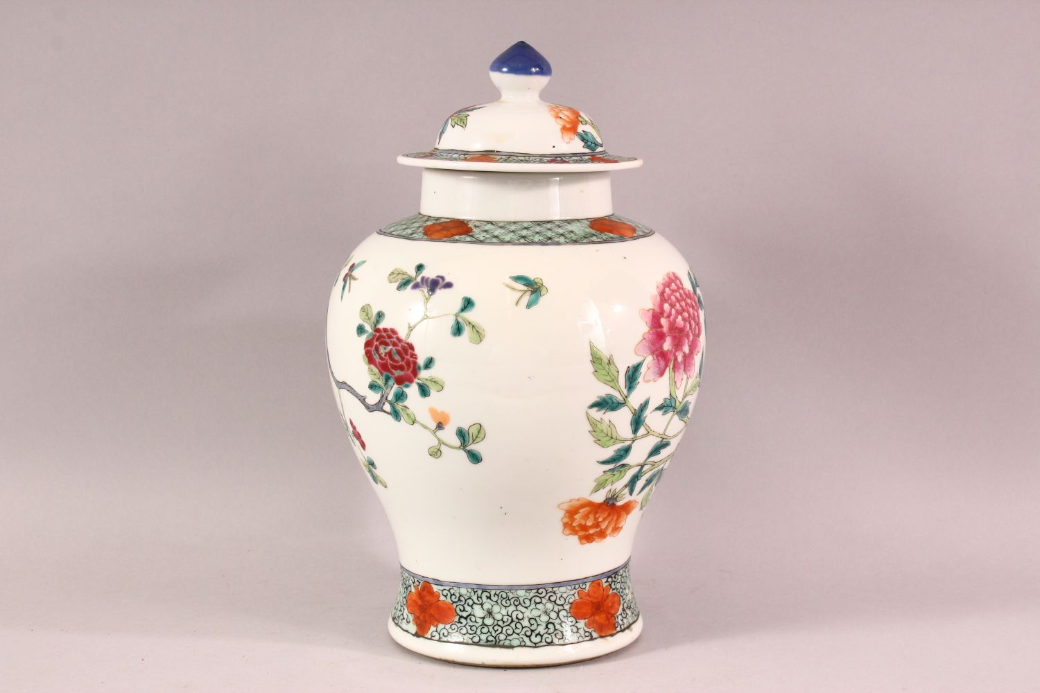 A CHINESE FAMILLE ROSE PORCELAIN JAR & COVER - decorated with scenes of native floral landscape - Image 3 of 8