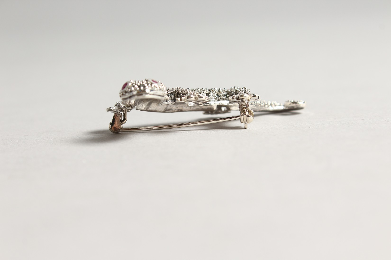 A SILVER MARCASITE AND RUBY LIZARD BROOCH. - Image 2 of 4