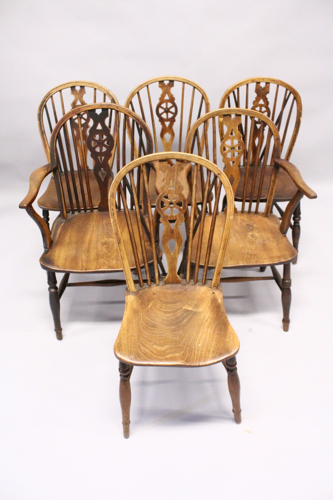 A GOOD SET OF SIX OAK AND ELM WINDSOR WHEEL BACK DINING CHAIRS, two with arms - Image 2 of 5