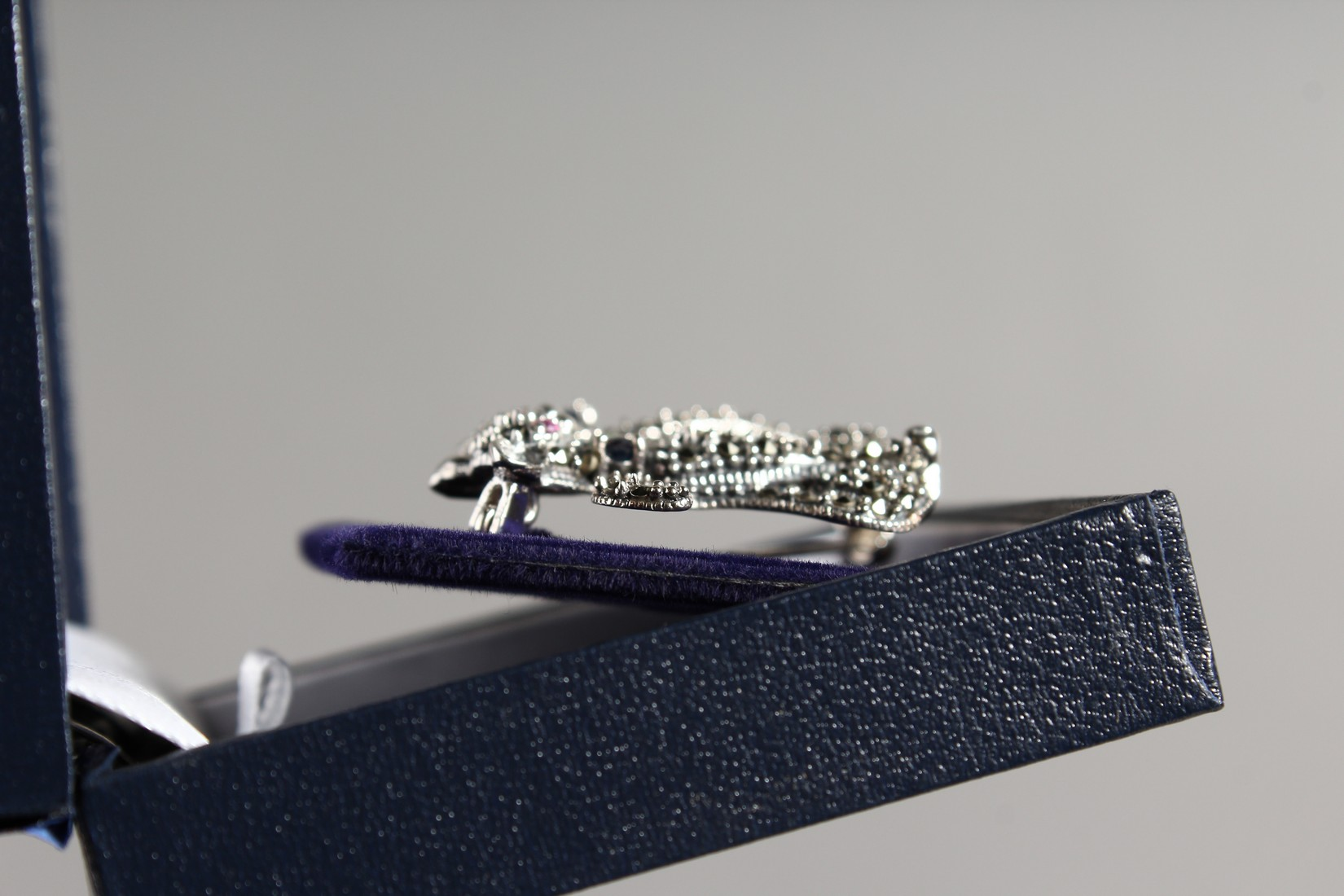A SILVER MARCASITE RUBY ENAMEL AND SAPPHIRE DOUBLE CAT BROOCH - Image 2 of 2