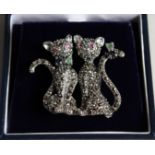 A SILVER MARCASITE RUBY ENAMEL AND SAPPHIRE DOUBLE CAT BROOCH