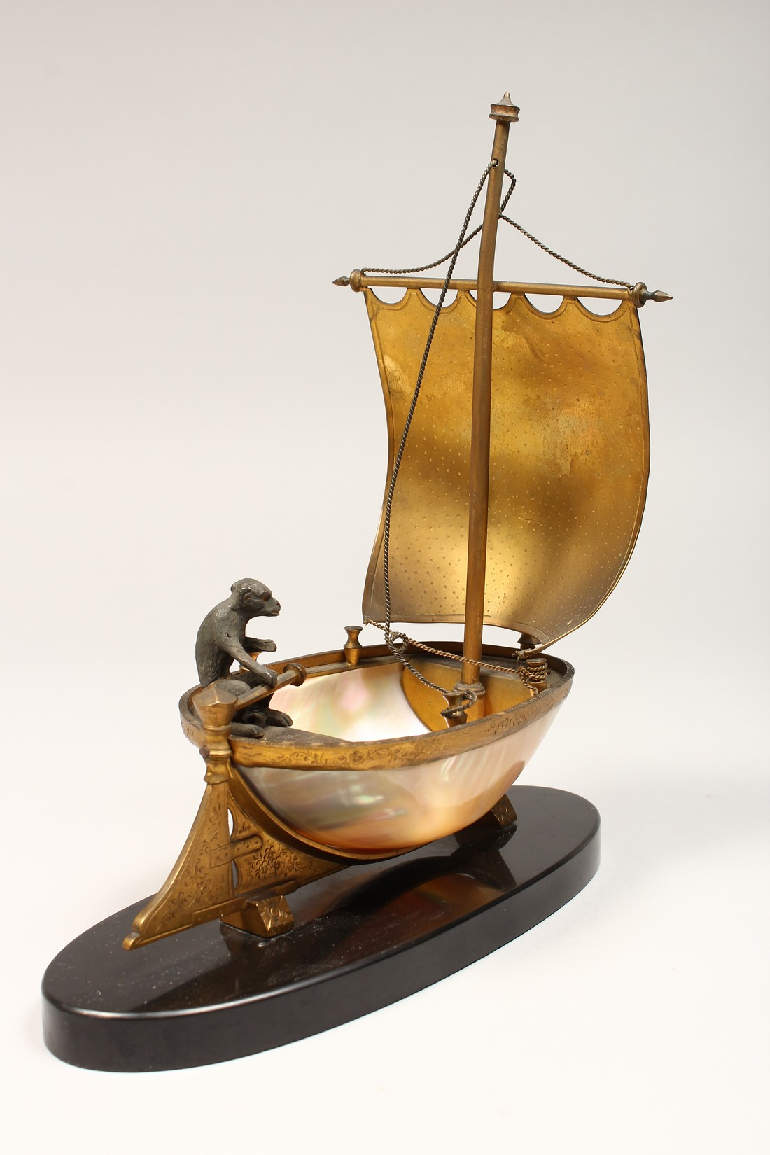 AN UNUSUAL LATE 19TH CENTURY FRENCH ORMOLU MOUNTED SHELL, mounted as a small sailing dinghy, a - Image 3 of 6