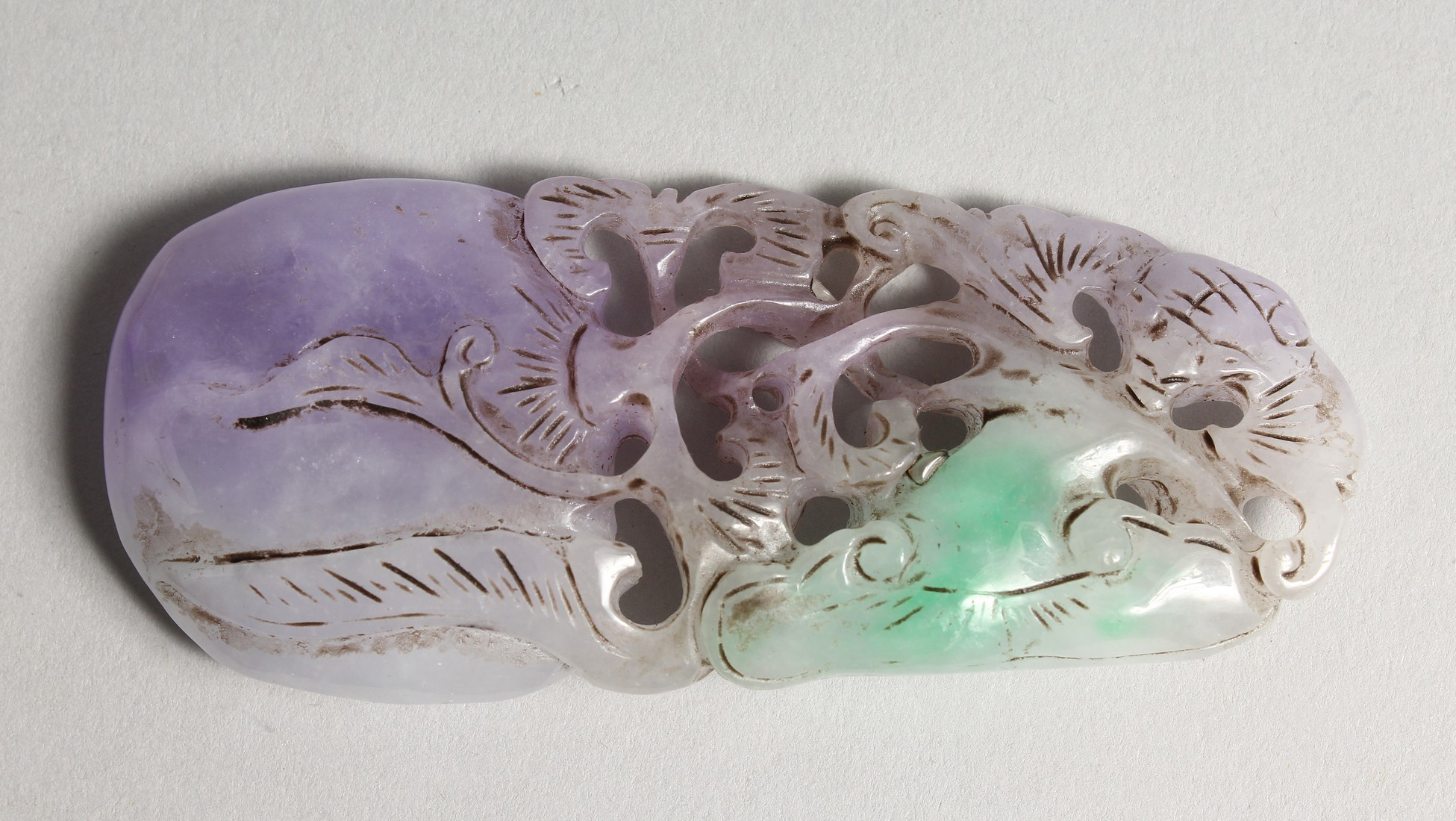A CHINESE CARVED LILAC JADE PENDANT 3.5ins long
