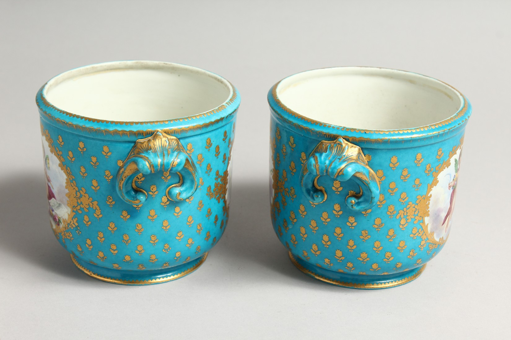 A GOOD PAIR OF SEVRES PORCELAIN CACHE POTS, blue groun painted with reverse panels of fruit. Mark in - Image 4 of 6
