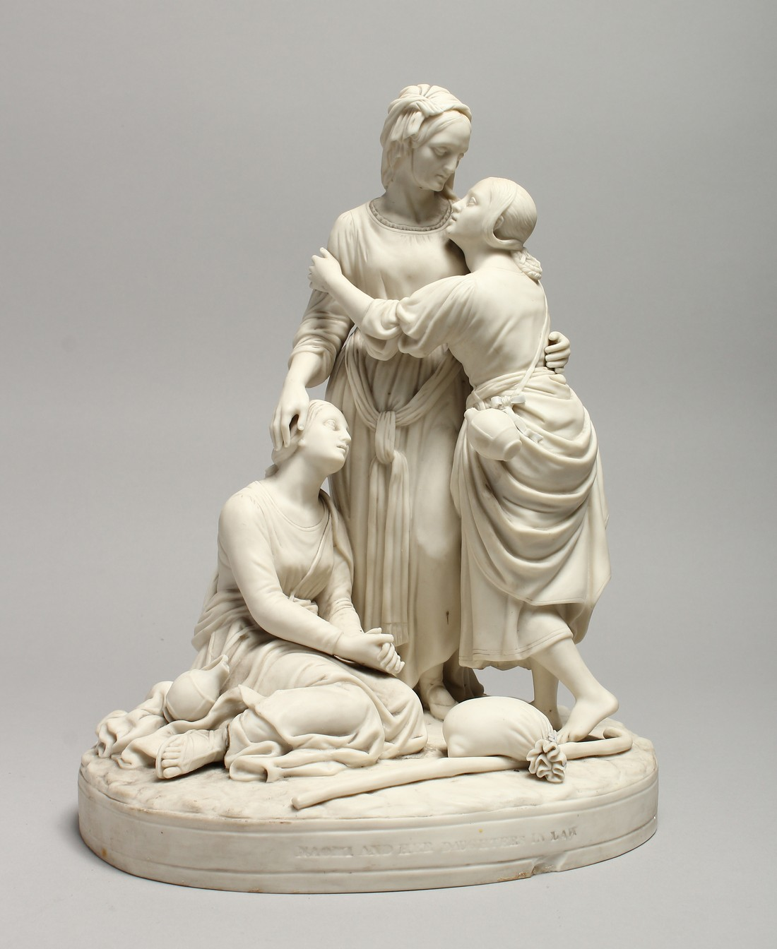 """A LATE 19TH CENTURY PARIAN WARE GROUP """"NAOMI AND HER DAUGHTER IN LAW"""". 13 ins high."""