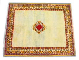 A MOROCCAN WOOL CARPET, 19TH CENTURY, cream ground with a central diamond shape design, with a