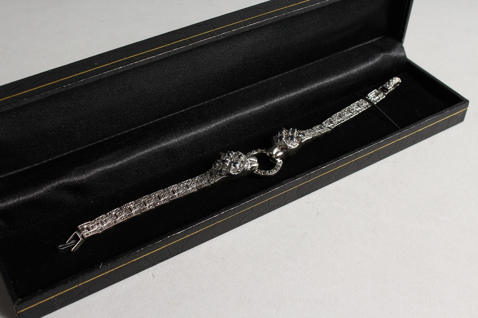 A SILVER, SAPPHIRE AND MARCASITE PANTHER BRACELET - Image 2 of 2