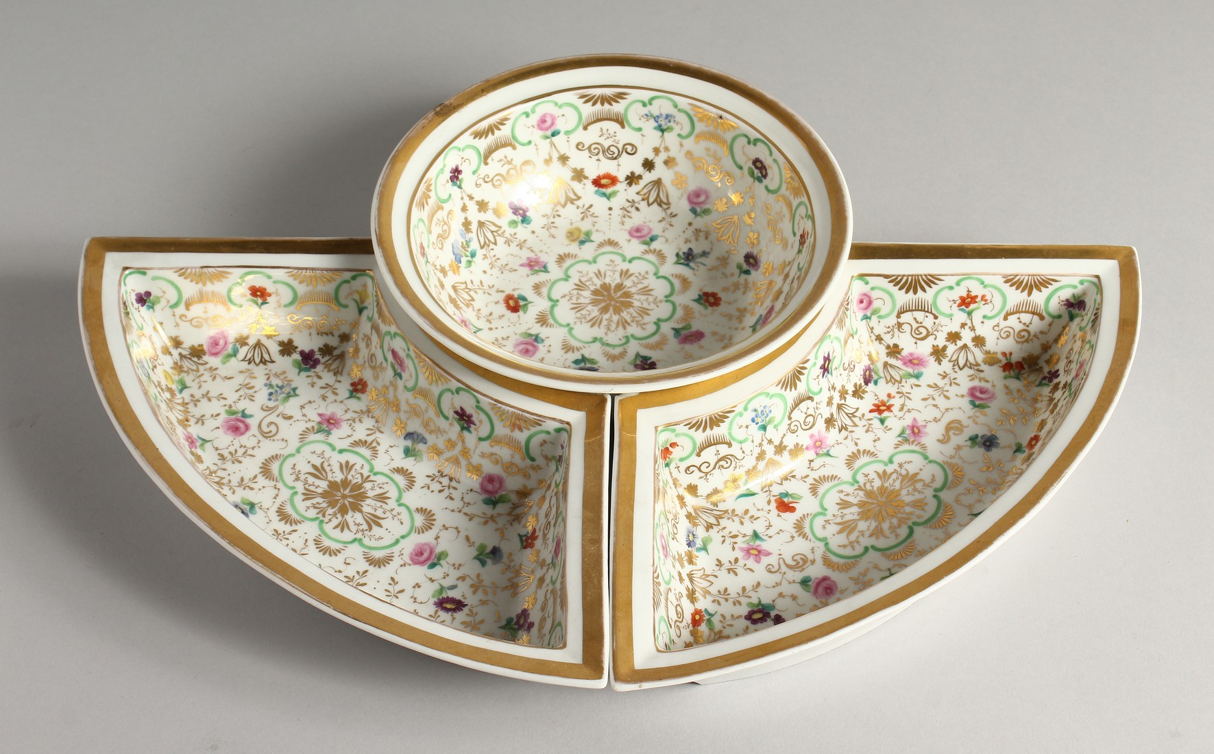 A K. P. M. PORCELAIN CIRCULAR BOWL with gilt decoration and painted with flowers. 7ins diameter