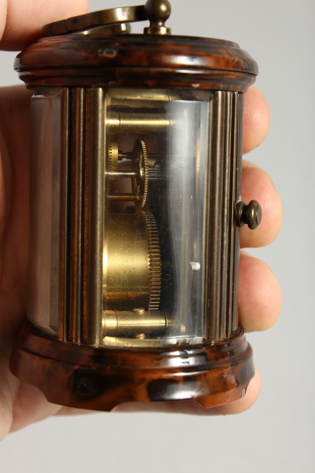 A GOOD CIRCULAR BRASS CARRIAGE CLOCK, MATTHEW NORMAN, LONDON. 3ins high - Image 7 of 7