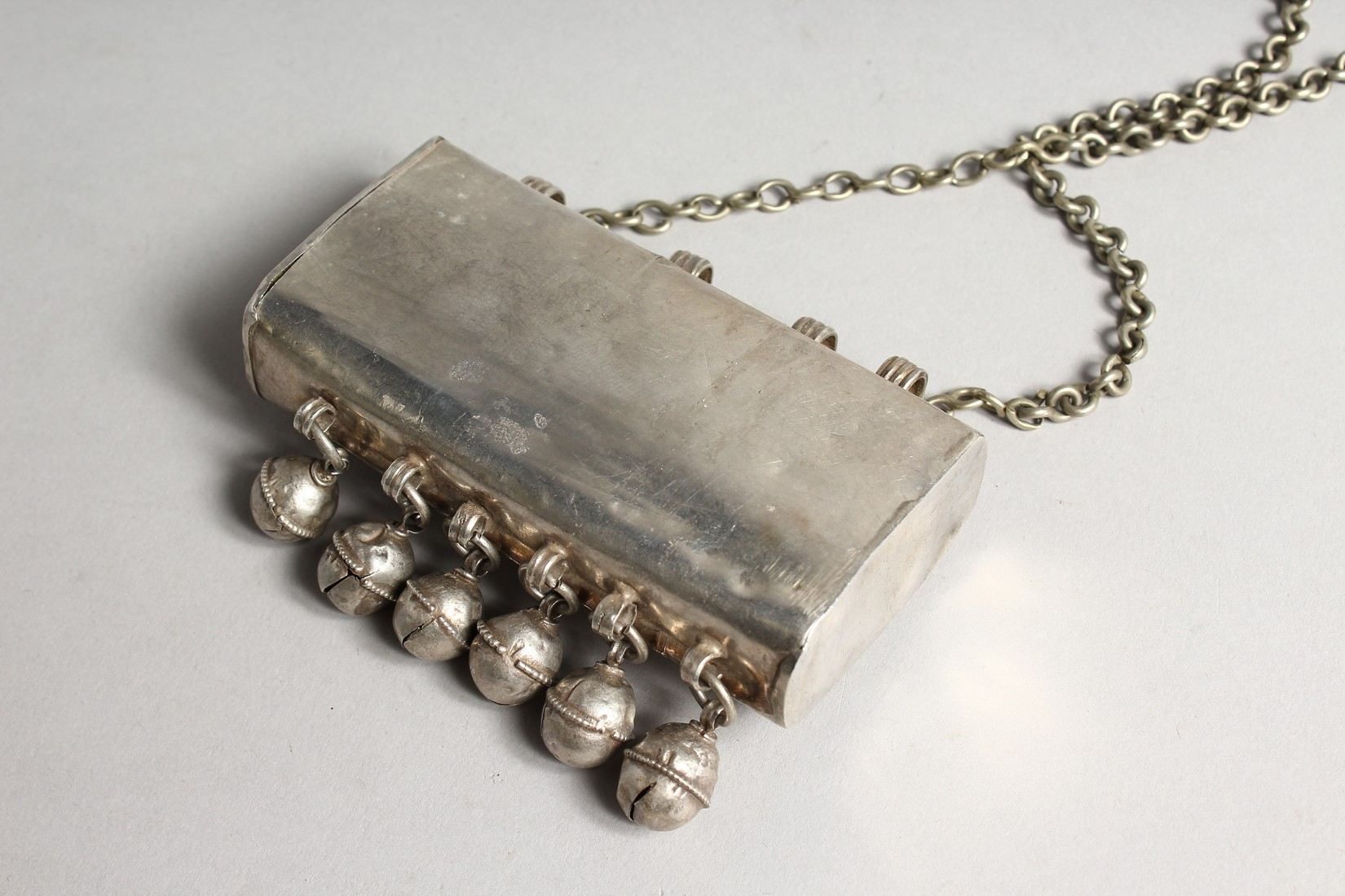 AN ISLAMIC SILVER BOX with bells, stone and chain - Image 3 of 3