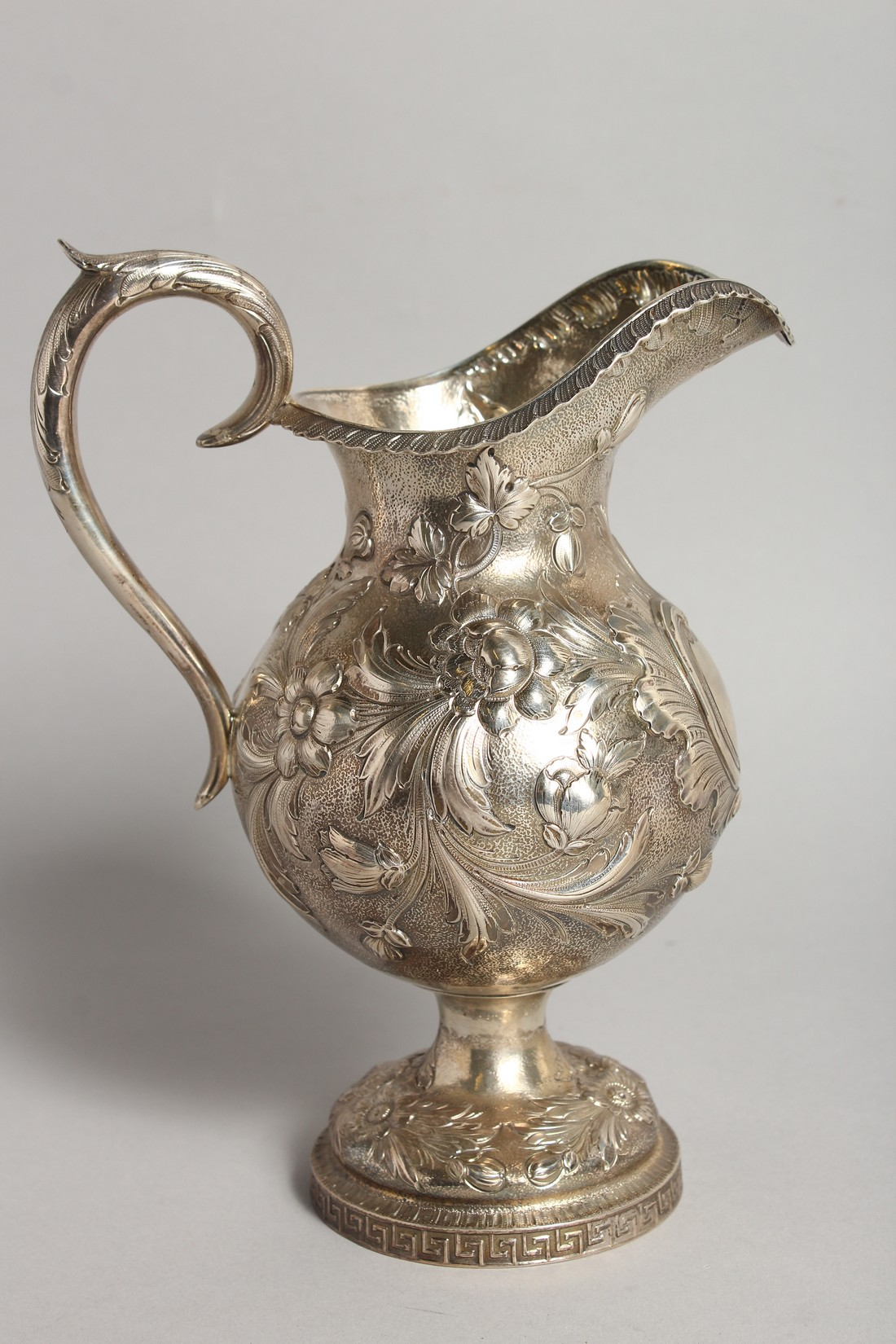 AN R & W WILSON 19TH CENTURY PHILADELPHIA SILVER JUG repousse with flowers and scrolls 8ins high, - Image 3 of 8