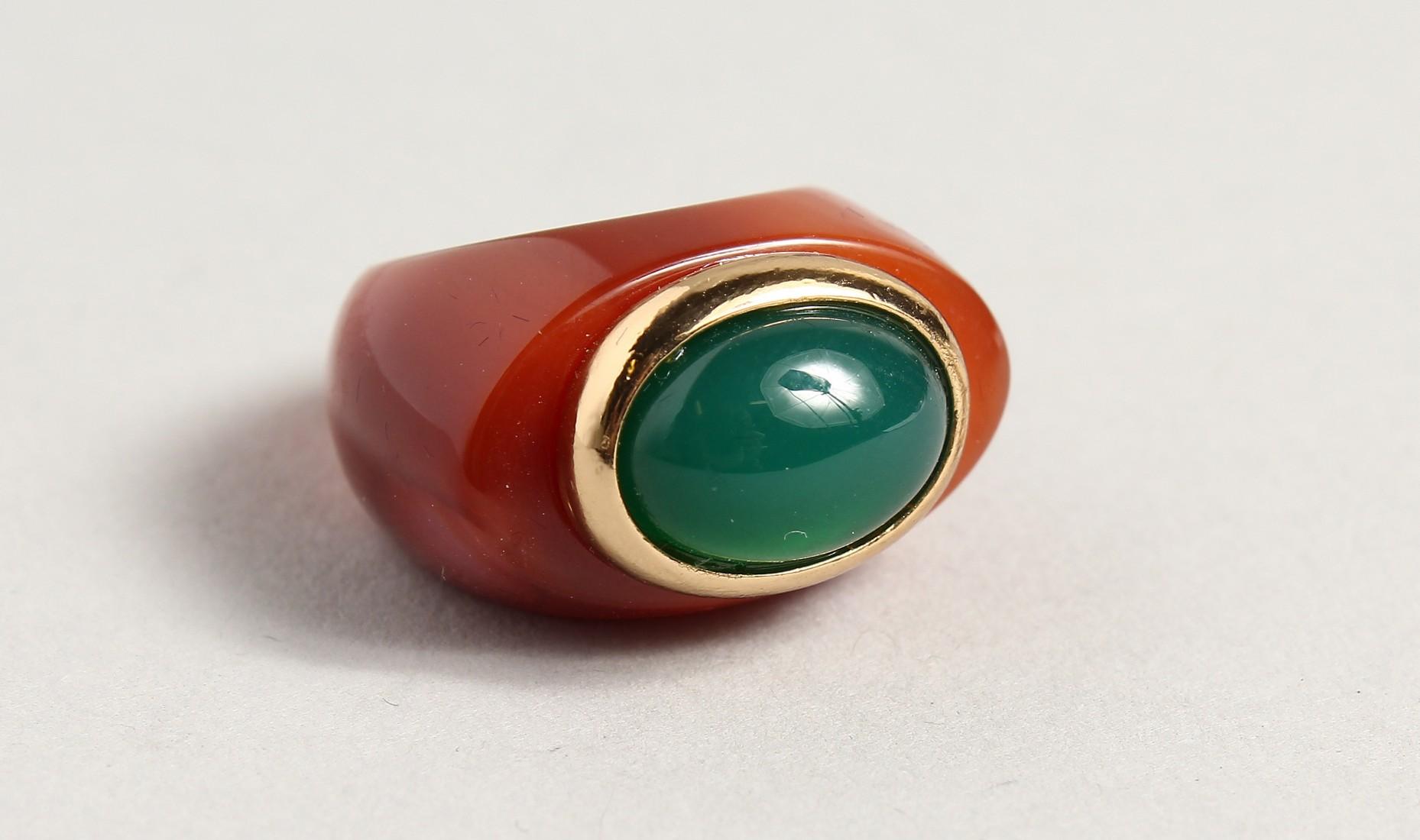 A GREEN STONE, DESIGNER RING.