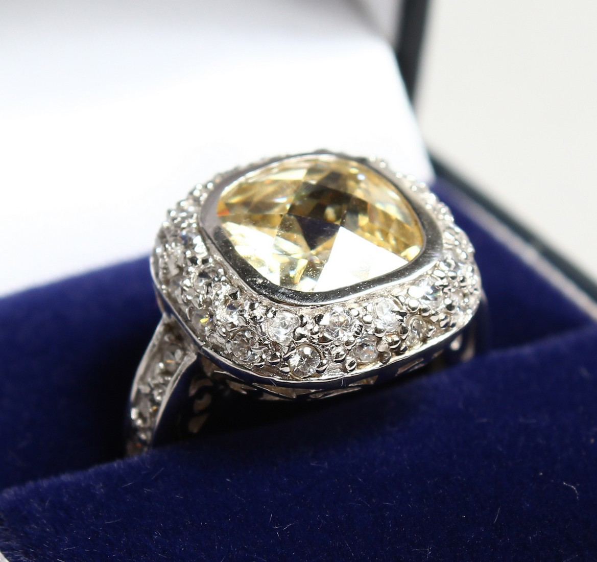 A SILVER CZ AND YELLOW RING
