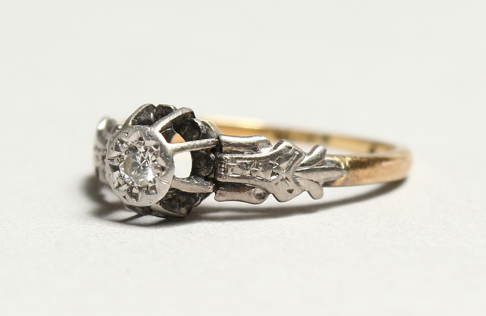 A GOOD 18CT GOLD DIAMOND SET RING