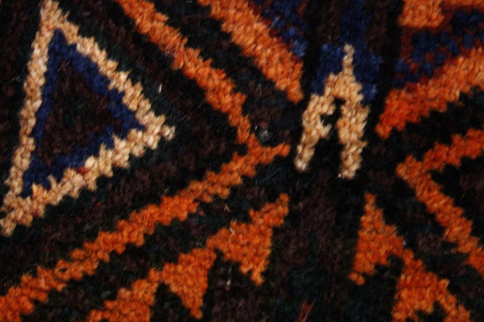 A BELUCHI PRAYER RUG, rust ground with stylised geometric design 5ft x 3ft 5ins - Image 4 of 4