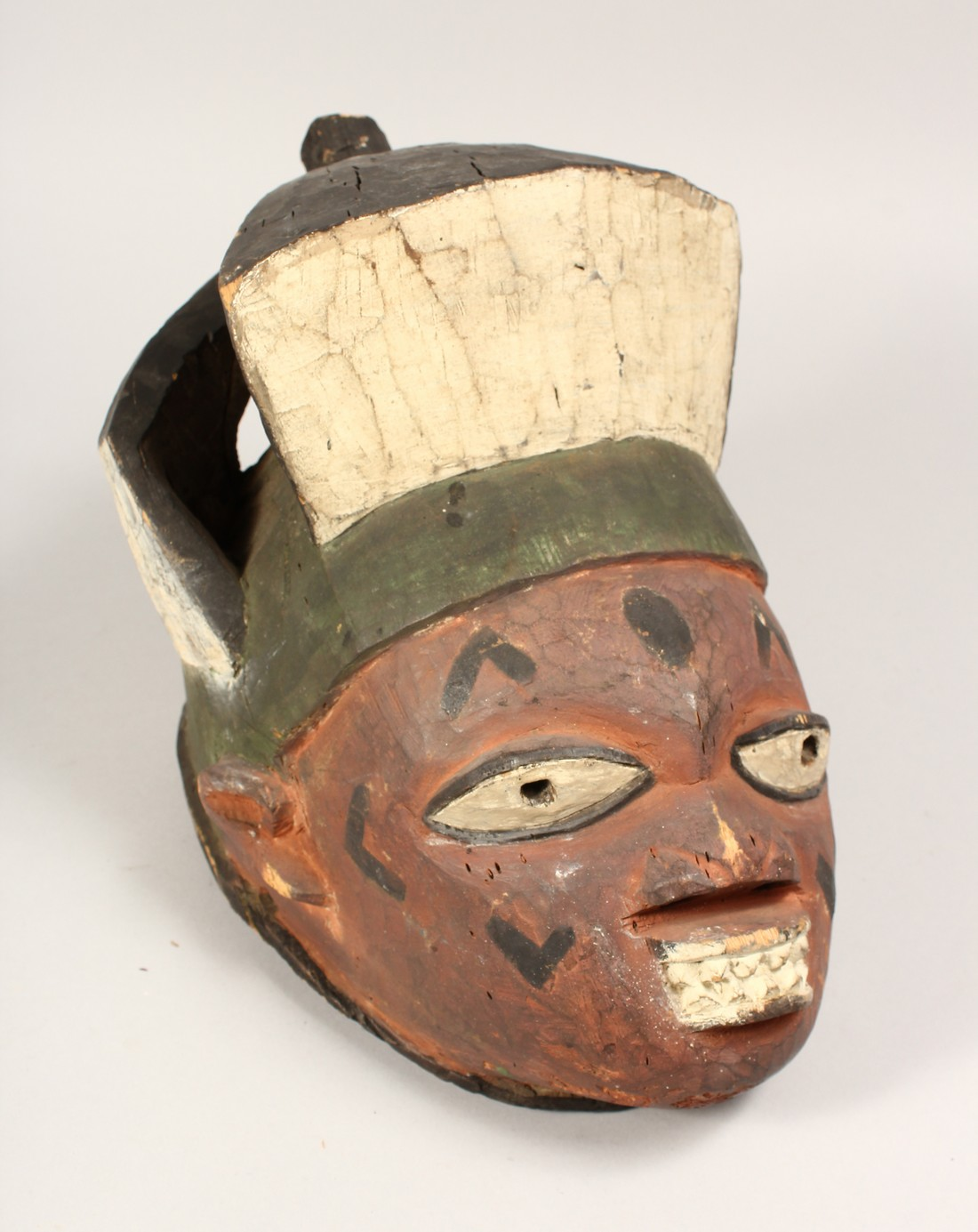 A PAINTED TRIBAL MASK 13ins long