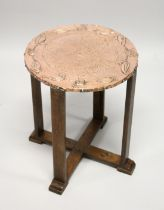 A GOOD ART NOUVEAU COPPER TOP CIRCULAR TABLE on four legs with cross stretchers 1ft 8ins high, 1ft
