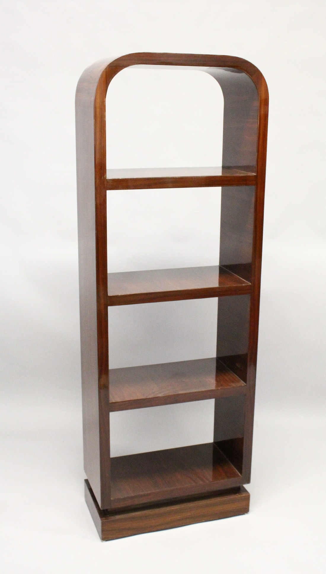 AN ART DECO STYLE ROSEWOOD BOOKSHELF with a rounded top and four shelves. 5ft 8ins high x 1ft 11.