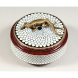 A CONTINENTAL PORCELAIN CIRCULAR BOX AND COVER, the top with a lizard. 5ins diameter.