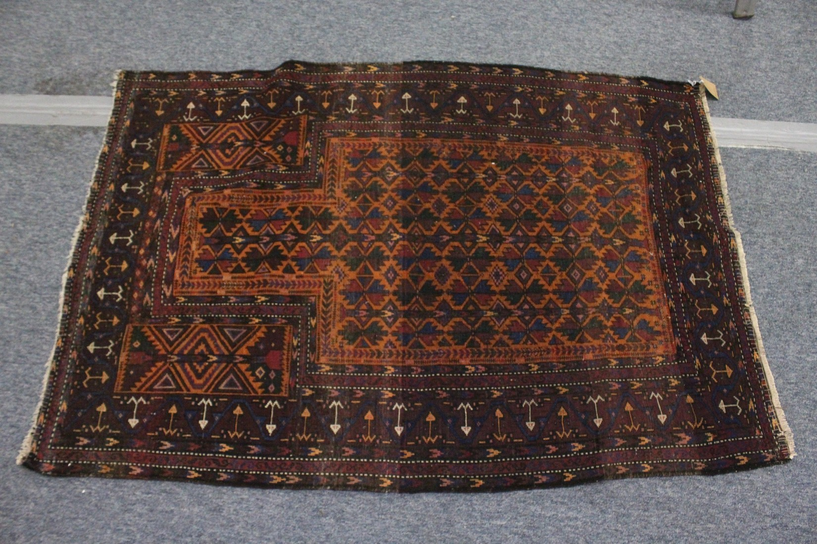 A BELUCHI PRAYER RUG, rust ground with stylised geometric design 5ft x 3ft 5ins - Image 2 of 4