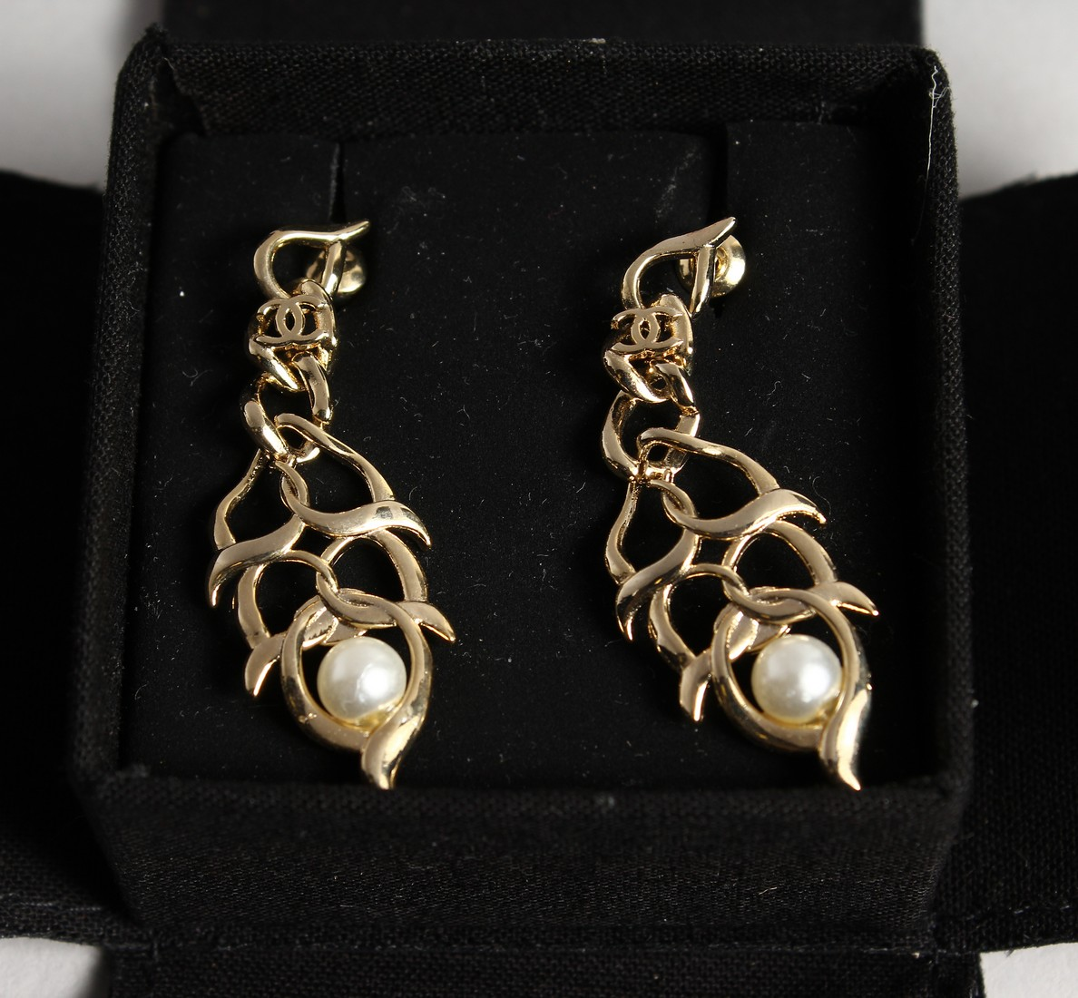 A PAIR OF CHANEL REPLICA EARRINGS in a box