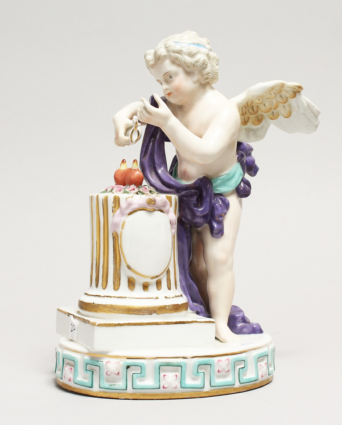 A DRESDON PORCELAIN GROUP, CUPID-LOVE, with two hearts on a pedestal. 8ins high.