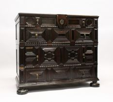 A GOOD LATE 17TH CENTURY OAK TWO PIECE LINEN FOLD FRONT CHEST, OF FOUR VARIOUS SIZE LONG DRAWERS,