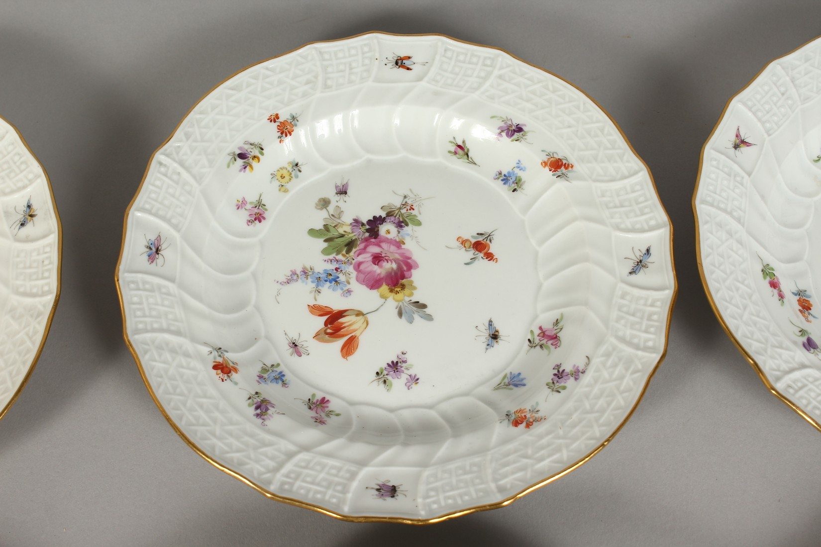 A SET OF EIGHT MEISSEN PORCELAIN DISHES with moulded gilt edged rim, each painted with flowers and - Image 7 of 11