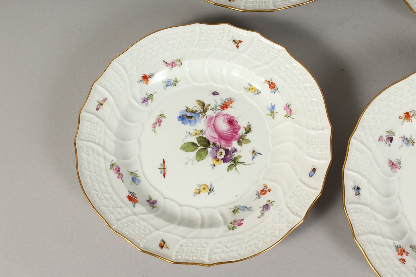 A SET OF EIGHT MEISSEN PORCELAIN DISHES with moulded gilt edged rim, each painted with flowers and - Image 2 of 11