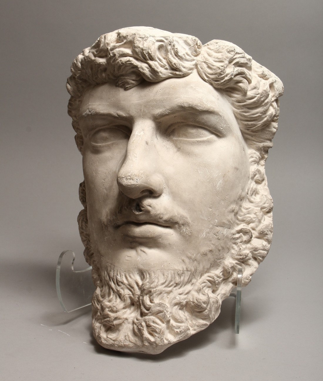 A RUSSIAN LARGE PLASTER HEAD OF A MAN 14ins long