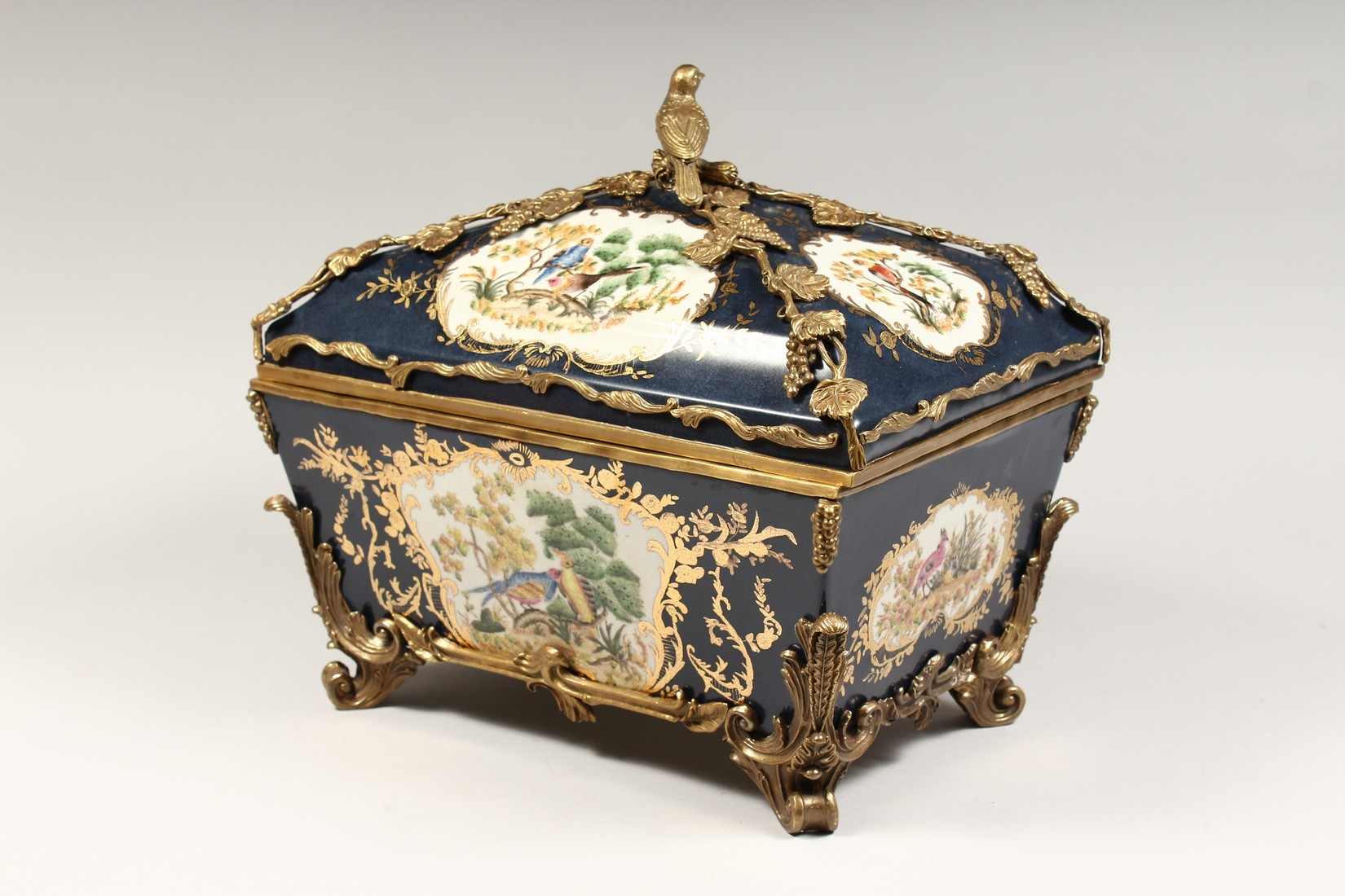 A DECORATIVE PORCELAIN AND ORMOLU MOUNTED SEVRES STYLE CASKET AND COVER. 15ins long - Image 2 of 5