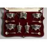 A VERY GOOD SET OF VICTORIAN SILVER CRUETS, comprising four salts and shell spoons, mustard pot