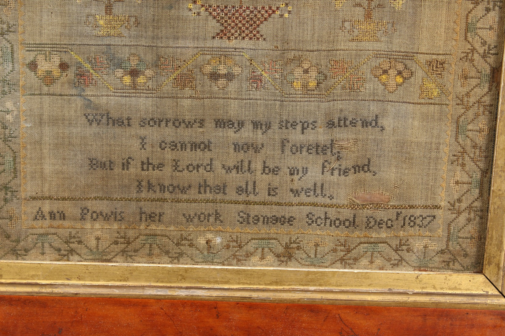 A 19TH CENTURY SAMPLER, depicting figures, flowers and a poem by Ann Powis dated 1837. 21.5ins and - Image 4 of 4