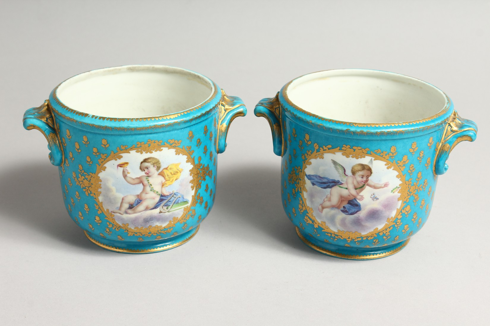 A GOOD PAIR OF SEVRES PORCELAIN CACHE POTS, blue groun painted with reverse panels of fruit. Mark in - Image 3 of 6