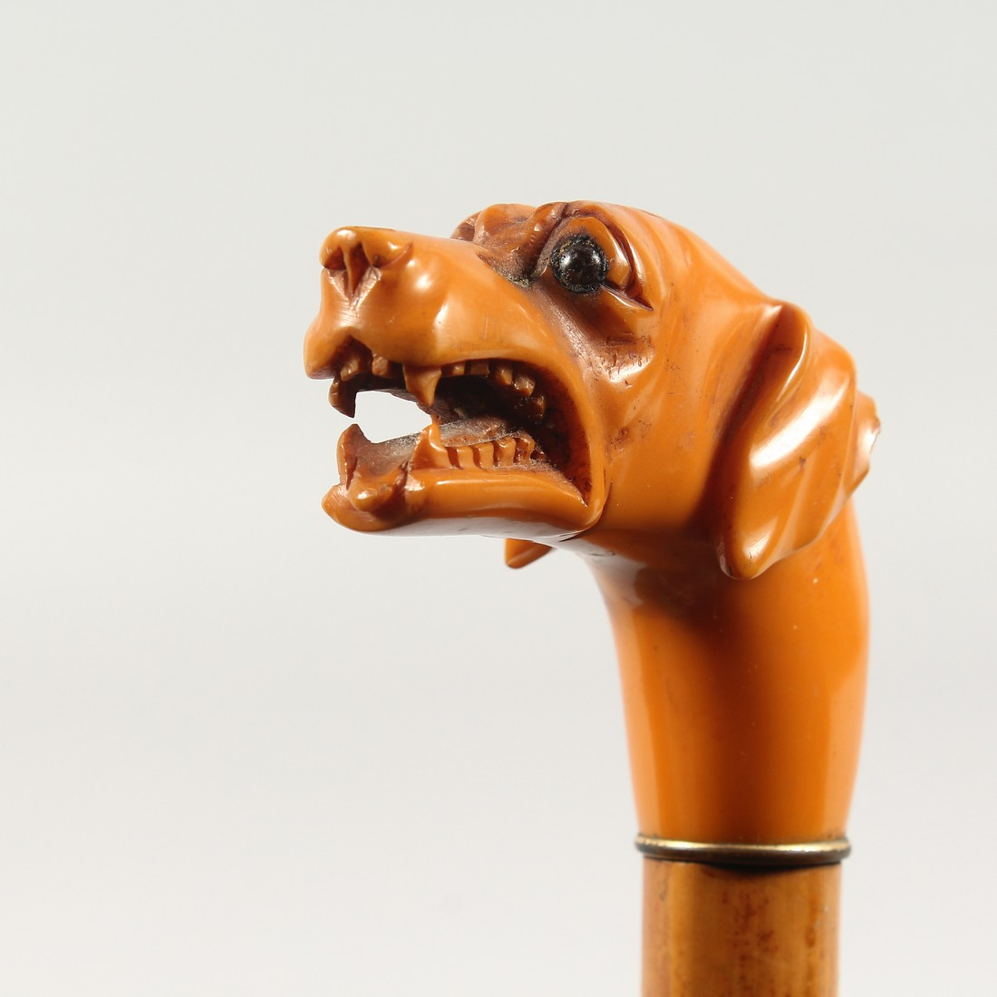 A 19TH CENTURY EUROPEAN WALKING CANE with carved ivory handle, deer in a landscape by BRIGG, LONDON.