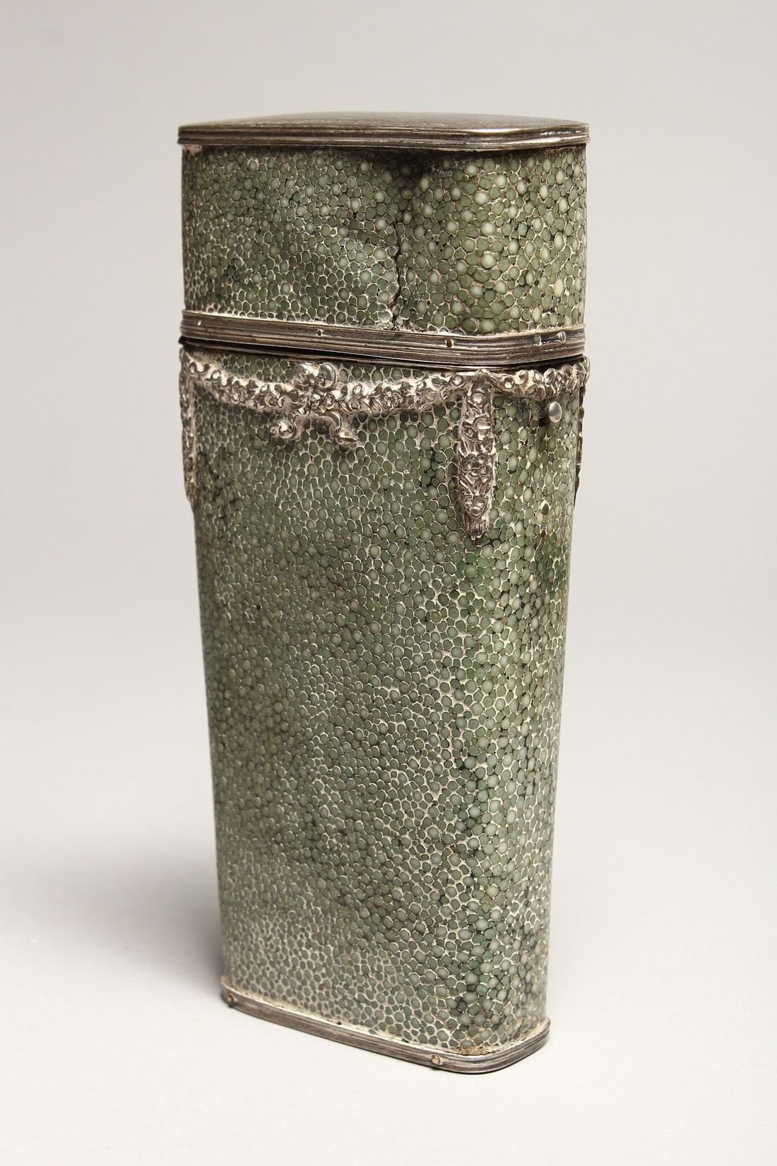 A GEORGIAN WHISKY FLASK in a shagreen case, with silver garlands 6.5ins long (some damage).