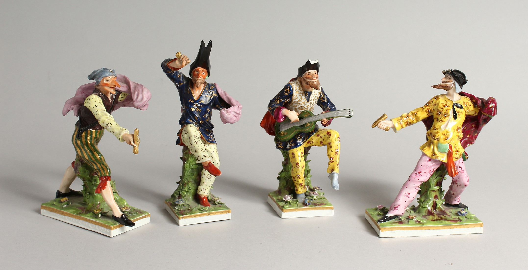 """A SET OF FOUR """"COMMEDIA DELL ARTE """" STYLE FIGURES, LATE 19TH CENTURY/EARLY 20TH CENTURY, possibly by"""